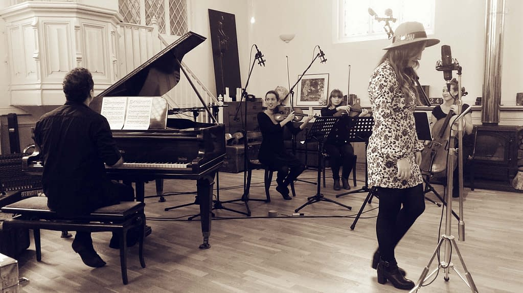 Jess Thristan recording with a String Quartet and Grand Piano